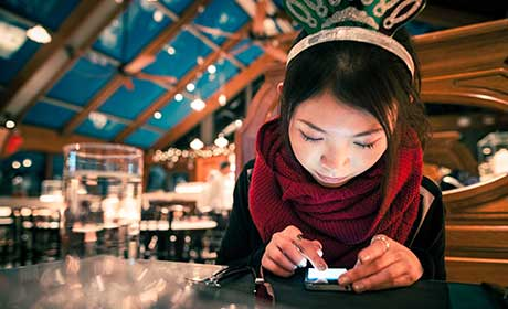 Cover image from the ACCA insights report Generation Next showing a young woman using her mobile phone