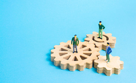 People stand on gears. Concept of business ideas and investments, cooperation and teamwork with business partners and employees. Business development, success.