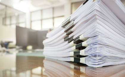 Useful documents acca global a large pile of documents on a desk each thick document held together with a spiritdancerdesigns Gallery